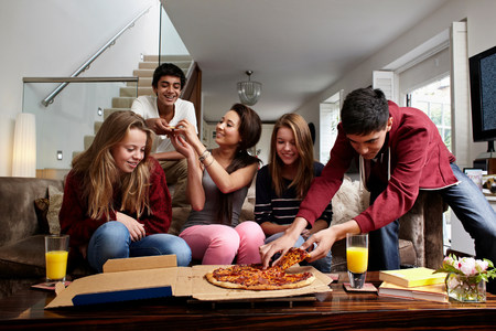 unfit: Teenagers having take away pizza