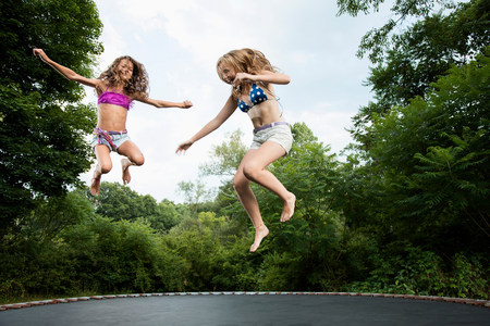 impulsive: Two girls on trampoline