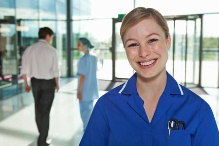 Portrait of nurse in hospital foyer