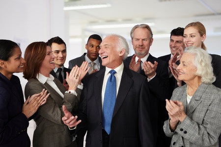65 70 years: Colleagues congratulating businessman