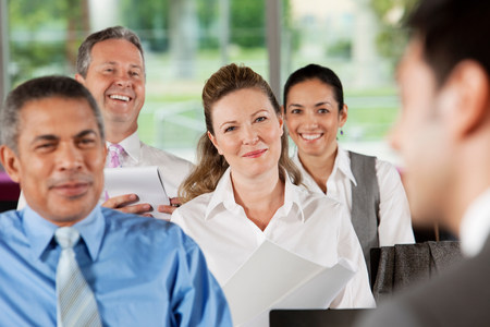 Businesspeople at presentation LANG_EVOIMAGES