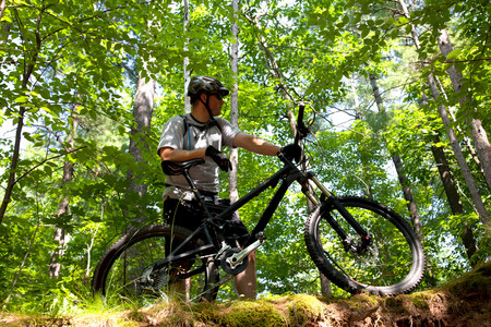Man in forest with mountain bike