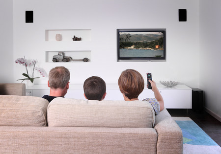 Family on sofa watching television,rear view LANG_EVOIMAGES