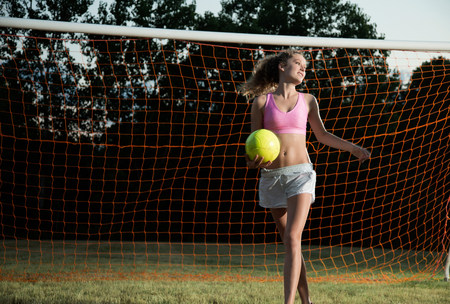 impulsive: Girl holding soccer ball