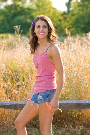 fenced in: Teenage girl standing in field