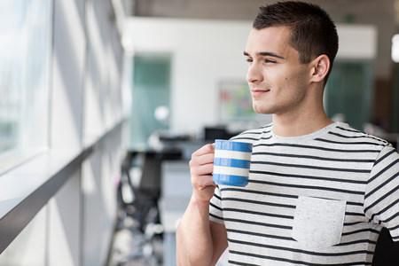 see through: Man taking coffee break LANG_EVOIMAGES