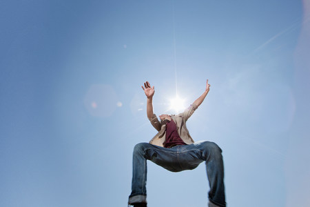 trouser: Young man jumping against blue sky,low angle LANG_EVOIMAGES