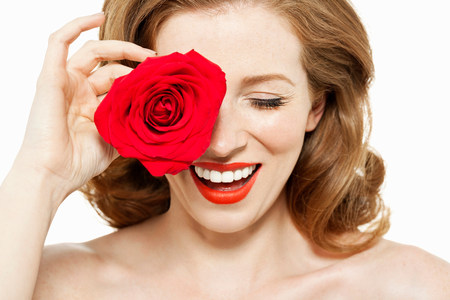half naked: Woman covering eye with red rose