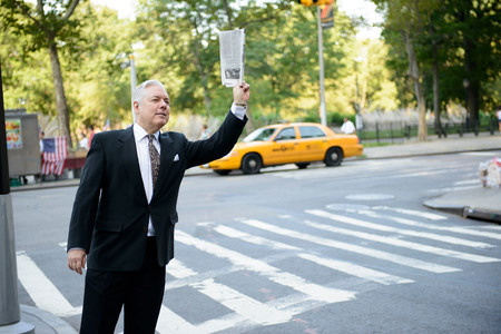 taxicabs: Businessman hailing a cab in New York City