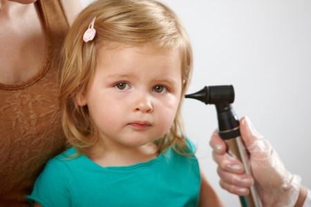 Little girl having her ear checked