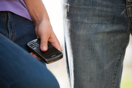 Young person holding smartphone,close up