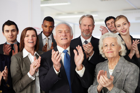 large group of business people: Businesspeople clapping LANG_EVOIMAGES