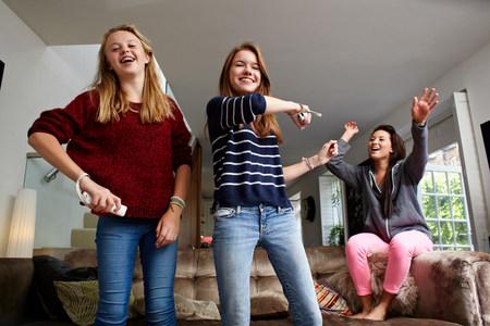 Teenage girls playing video game