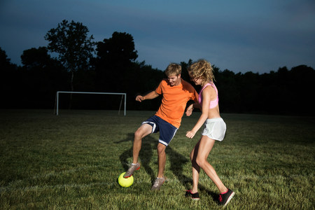 impulsive: Friends playing soccer at night