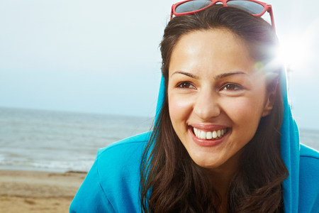 russian ethnicity: Young woman in hooded top on beach