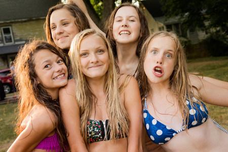 Portrait of five girls wearing bikini tops