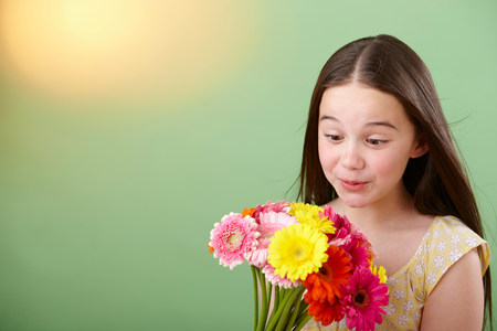 Girl with bunch of flowers LANG_EVOIMAGES