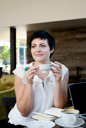 Young woman in cafe with tea LANG_EVOIMAGES