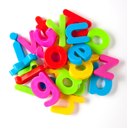 Alphabet fridge magnets in a pile