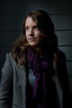 ponderous: Smiling woman wearing purple scarf LANG_EVOIMAGES