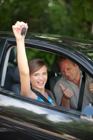 proudly: Father giving teenage daughter new car