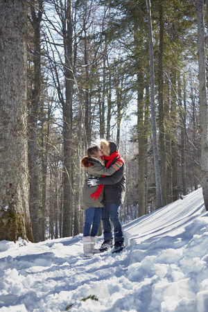 anorak: Couple kissing in snow