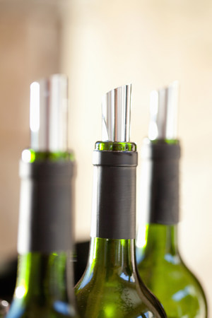 Close up of metal corks in wine bottles
