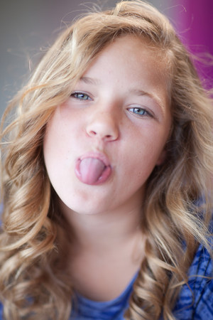 silliness: Girl sticking her tongue out LANG_EVOIMAGES