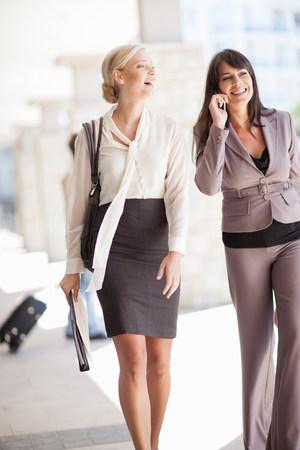Businesswomen walking together LANG_EVOIMAGES