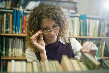 curiousness: Student searching for book in library