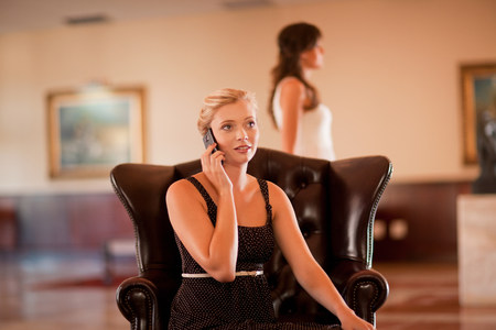 Woman talking on cell phone in lobby