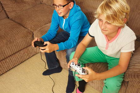 two persons only: Two boys playing video game