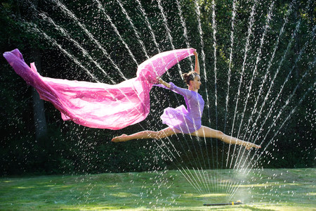 purples: Ballerina leaping over water sprinkler with fabric
