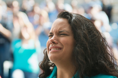 Female spectator looking upset