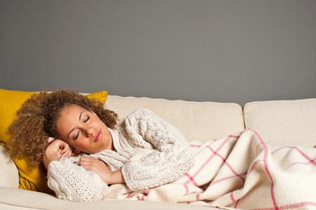 snoozing: Woman asleep on sofa