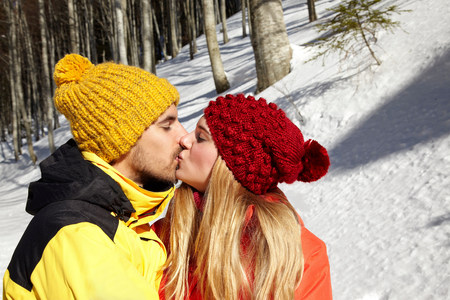 wintry weather: Couple kissing in snow