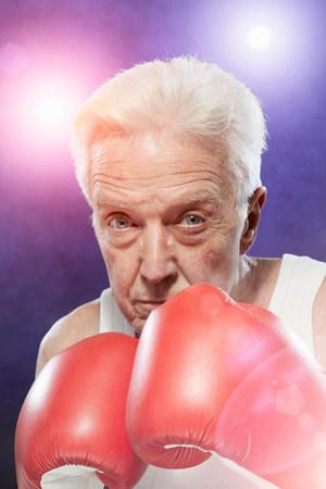Senior man in boxing gloves LANG_EVOIMAGES