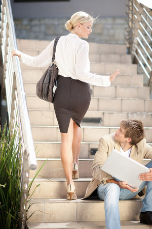 Business people greeting on steps