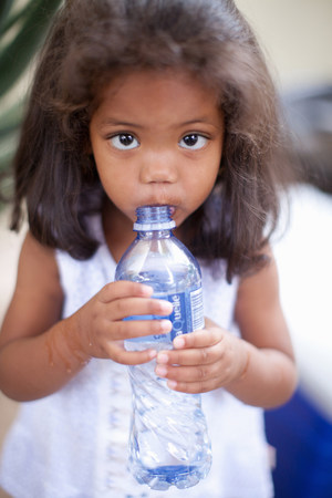 Girl drinking out of water bottle LANG_EVOIMAGES