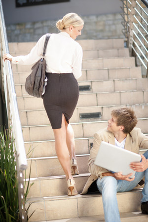 turning the page: Business people greeting on steps