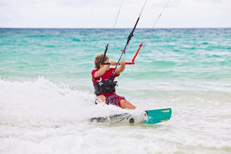 kiteboarding: Boy kitesurfing