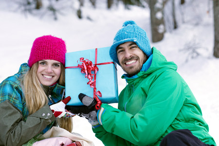 Couple holding christmas gift