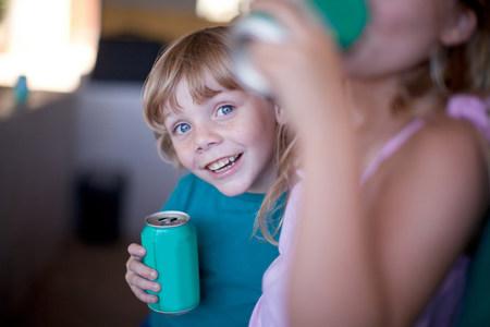 held: Children drinking soda in garage
