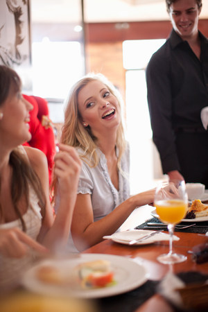 Women having breakfast together in cafe
