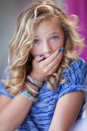 gasping: Girl gasping with hand over mouth