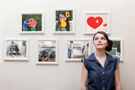 ponderous: Young woman in front of wall of photographs