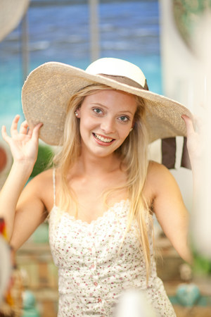 sunhat: Smiling woman shopping in store