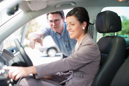good color: Salesman showing woman new car