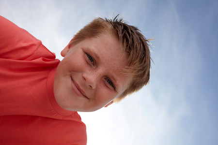 casual clothing 12 year old: Boy looking at camera,viewed from below LANG_EVOIMAGES