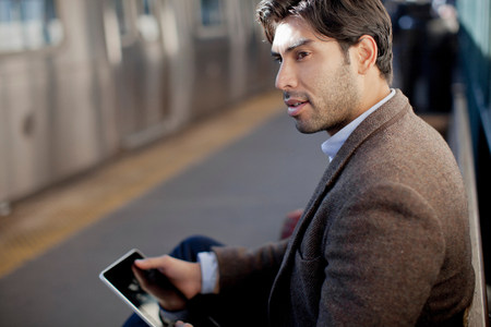 information superhighway: Man using tablet computer at station